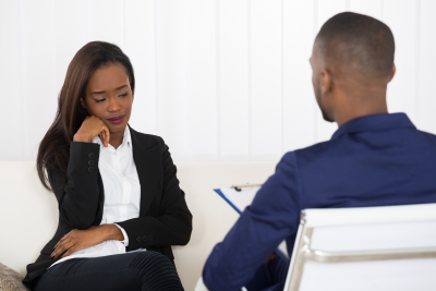 psychologist having a session regarding to depressed woman emotion